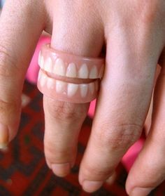 A ring made of dentures.   29 Gloriously Insane Things You Can Buy On Etsy