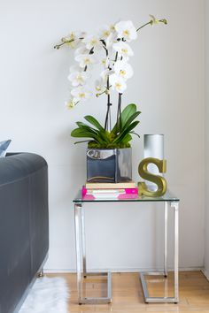 Sydne Summer's West Hollywood Home // home decor // grey couch // side table // monogram // living room // Photography by Monica