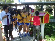 Here is the LFL we donated to the Bakersfield Ronald McDonald House. Scarlett, the director, is shown being filmed by ABC while loading it with books. The Roadrunners Volleyball team is cheering her on.