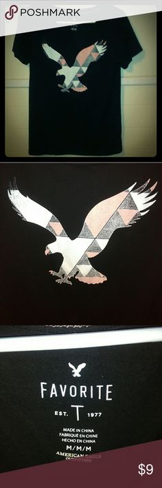NWOT American Eagle Black Favorite T-shirt NWOT American Eagle Black Favorite T-shirt. Has colorful eagle on front in gray, pink and white. Stretchy material. American Eagle Outfitters Tops Tees - Short Sleeve