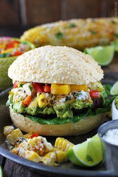 (sub veggie patty) Grilled guacamole burgers piled high with roasted Mexican-style corn and fresh mango red pepper salsa - so much easier than they look and wayyy too good to pass up! Guacamole Burger, Paninis, Clean Eating, Healthy Eating, Vegetarian Recipes, Cooking Recipes, Healthy Recipes, Food Porn, Main Dishes