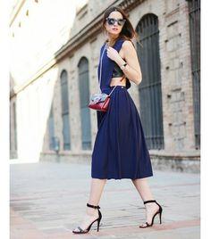 On Zina Charkoplia of Fashion Vibe:  & Other Stories dress; Purification Garcia sandals; Paula Cademartori Anna Leather And Suede Clutch ($935); Marc Jacobs sunglasses, Daniel Wellington watch.