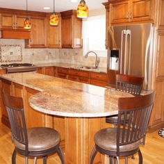 Take a look at the stunning Crema Bordeaux granite used in this Westport, MA kitchen. We love it!