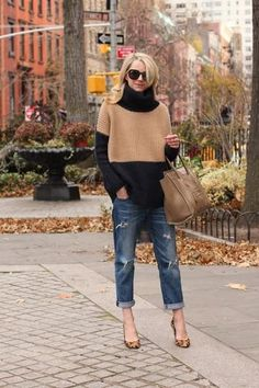 winter outfit idea - oversized colorblock turtleneck sweater worn with cuffed boyfriend jeans + leopard print heels