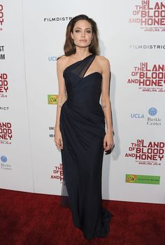 For her In the Land of Blood and Honey premiere, she wore this navy, asymmetrical bustier dress from little-known designer Romona Keveeza.   - MarieClaire.com
