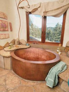 cob bath-interesting use of stones instead of having to tile.