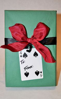 An unusual gift tag can add unexpected whimsy to your present. Try a playing card, a vintage flash card or a personalized wrapped cookie!