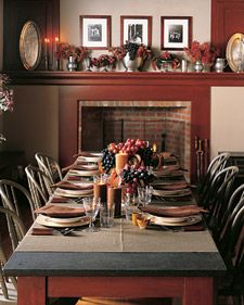 Lovely, rustic Thanksgiving table.  Love the rich, deep, autumnal color scheme and the use of grapes.