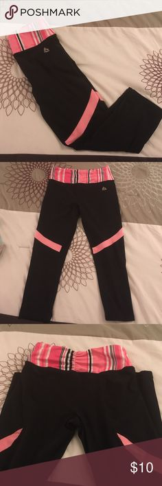 "RBX Capri legging workout pants Black, with a cute pink and white stripe accent across the thick yoga band waist. Waist measures 13.5"" but is stretchy, as is the rest of the fabric. Great condition! These are tight fitting. RBX Pants Leggings"