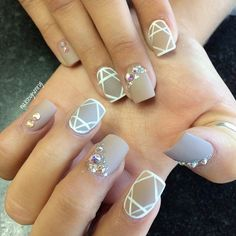 Nude and white abstract nail art design. Coat your nails in matte nude base while adding linear patterns on top using white polish. To give more attitude to your nails, add colorful and pretty embellishments to top it as well.