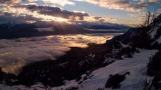 Sunset over the cloud blanket covering El Bolsón and the Rio Azul valley. Photo taken from the Refugio Piltriquitron. Snow Camping, Visit Argentina, Forest Trail, Mountain Sunset, Above The Clouds, Blanket Cover, Local Artists, Trekking, Trip Planning