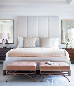 Double Vision, Mirrors from RH, white lamps by Thomas Pheasant for Baker and twin leather benches from Baker create elegant symmetry in the master bedroom. Custom shams are in a Fortuny fabric. Cashmere throw is from Sue Fisher King. Wool rug is through Niba.