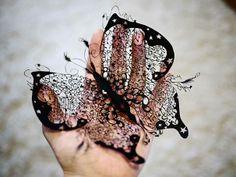 Borboleta - uma obra de arte feita com uma simples folha de papel.