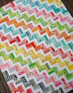 'Zigzag' quilt with three rectangles per square, (one light and one dark in each single colour and one white.)
