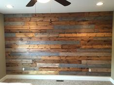 Wood wall in our bedroom that we made with stained 2x6 boards.