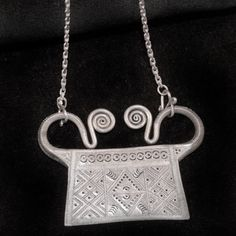 A friend of mine is Hmong and I find the aesthetic absolutely beautiful.  Hmong necklace