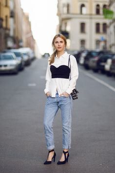 Pernille Teisbaek of Look de Pernille in a clean white blouse, jeans, and bustier // #Fashion #StreetStyle
