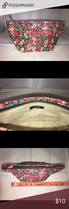 JCREW silk bag. EUC, a clutch or makeup bag Cute JCREW POUCH. It has a cute berry branches design on silk fabric. Tan canvas lining and a pocket inside.   Can be used as a clutch or cosmetic bag.  I used it once as a coupon pouch. Clean, no signs of use.   Non smoker  BUNDLE TO SAVE 💲💲💲👜🛍 MAKE ME AN OFFER.!  I'm considering any reasonable offers.  I had to quit b/c of my heath. I have a ton of great like new clothes and purses I no need for! J. Crew Bags Cosmetic Bags & Cases