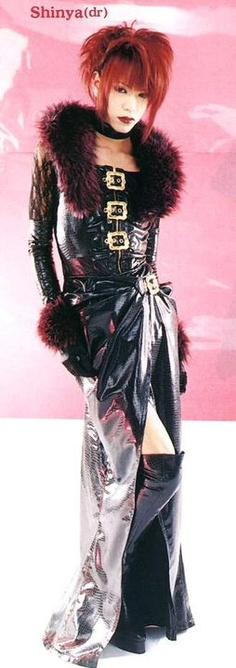 Shinya. Haha, he looks great in a dress, much better than me! (Dir En Grey)