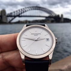 """Patek, around the world ••••••••••••••••••••••••••••••••••• Time Piece: Patek Philippe Reference: 5296G Where: Sydney Harbour Bridge Who:…"""