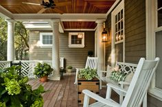 This is a great idea for a front porch. I like that its covered and has plenty of seating and areas for plants. It needs a swing.