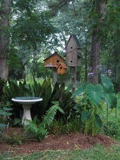 Shady birdbath and birdhouses: The western sword ferns suggest this would work in my Northern California yard!
