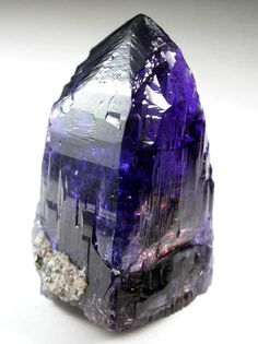 Tanzanite-Promotes compassion, raises consciousness in meditation.  Calms an overactive mind. Enables self realizations of your true inner self.