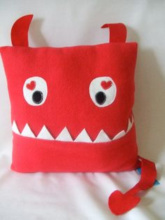 Red monster pillow with pocket by MisfitMenagerie on Etsy, $25.00