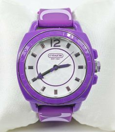 Coach Signature Boyfriend Silicon Rubber Purple Watch Gift Box Coach. $149.95. Color: Purple / Silver Hardware. Quarts movement, mineral crystal. H: in x W: in x L: in. Plastic case with silicon rubber strap - Water resistant up to 99 feet. Gift Box