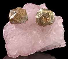 Pretty combination featuring rounded Pyrite crystal balls on pinkish-purple Fluorite. From Dayu County, Ganzhou Prefecture, Jiangxi Province, China.