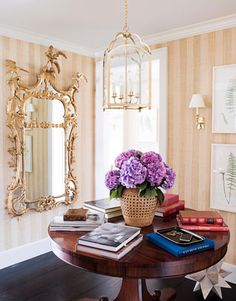Foyer, beautiful walnut or is it mahogany cant tell pic too small, but fantastic.  love it.. it would be a great breakfast  table.  walking on sunshine :-)   via:housebeautiful.com