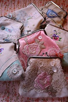 Embroidered purses.  **no info, just pictures.  But they sure are pretty little purses.  DeR