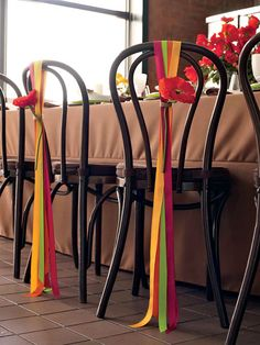 Brides: Rainbow Ribbon and Bloom Chair Decor. Ribbons and flowers tied with twine dress up the bride's and groom's chairs.