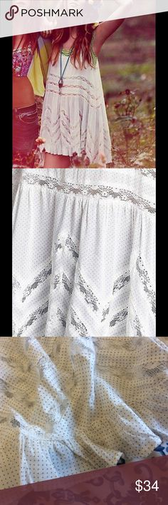 ✨ FREE PEOPLE lace and Voile Trapeze Dress dot S Awesome Voile and Lace Trapeze slip dress by intimately Free People. It's got to be one of their most popular pieces! NEW with tags but has a small factory defect as shown on the third photo. Price reflected! White with light grey Swiss dots. Size S. Get an authentic piece for a fraction of the retail quote. Free People Dresses Mini