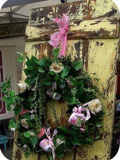tea cup wreath on an old door...i love the old yellow weathered door too!!!!......