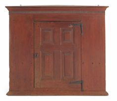 Lancaster County, Pennsylvania walnut hanging corner cupboard, 18th c., the molded cornice with a matchstick band above a raised panel door with original iron hinges, 34 H. x 36 W.  Provenance: Hattie Brunner