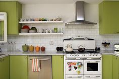 Love the subway tile backsplash, but how do you keep open shelves with dishes from getting too dusty/dog hairy?