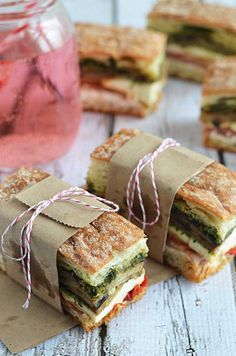 Eggplant, Prosciutto, and Pesto Pressed Picnic Sandwiches. These look good.