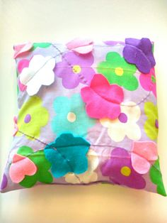 Creative; the flowers of the fabric-design made in felt on it.