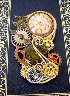 Steampunk Brooch (Pin123) - Clockwork Design - Wings and Compass - Gears and Swarovski Crystals -. $40.00, via Etsy.
