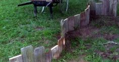 """I have a tremendous amount of amusement creating fun and new decorative garden beds in our garden. Today, I wanted to share a simple """"How-T. Pallet Gardening, Pallets Garden, Flower Garden Borders, Newspaper Flowers, Outdoor Flowers, Lawn Care, Raised Garden Beds, Flower Beds, Amazing Gardens"""