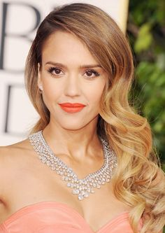 Jessica Alba goes double glam at The Golden Globes with the Veronica and 1940's inspired make up and who would blame her this look is sure to turn heads.