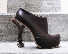 black leather booties with antler heels. beautiful.