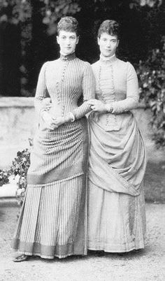 Cabinet photograph of Queen Alexandra when Princess of Wales and her sister Empress Maria Feodorovna of Russia full-length portrait, holding hands, standing outside. Signed Alix and Minny and dated below.