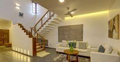 കൗതുകങ്ങൾ നിറയുന്ന വീട്, ഒപ്പം വാസ്തുവും! വിഡിയോ   Home Plans Kerala   House Plans Kerala   Home Style   Manorama Online Stairs In Living Room, House Stairs, Living Room Kerala, Beautiful Small Bathrooms, Staircase Design, Stair Design, Kerala Houses, Kerala House Design, Brick Architecture