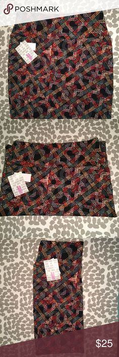 Lularoe Medium Cassie Skirt NWT. Very Geometric patterned skirt. Black background, mustard, white, grey-teal, purple and red. Love that you can pick so many different solid tops to match this skirt. Super stretchy. LuLaRoe Skirts Pencil