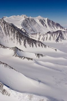 Mount Vinson above the lower ridges of the Vinson Massif, seen from a Twin Otter. Antarctica