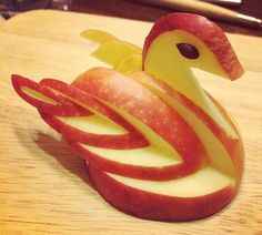 Duck made from red apple