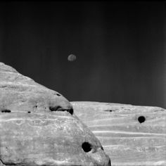 """Matteo Cirenei  Italy   Black & White Spider Awards, 8th Winners & Nominees Gallery  Matteo Cirenei, Nominee/Nature/Professional  """"The Moon at Canyonlands""""  Walking on trials in Canyonlands' National Park, the Moon shining in the blue sky.. a triptych of round shapes"""