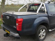 """This Aluminium Tonneau Covers with Sport bar is fabricated from 3mm Aluminium 5 bar tread plate. The tonneau cover locks into your pickup bed using a recessed T handle and rod lock system, which makes it very secure, when in the locked down position.  The Sport / Roll Bar is manufactured from BIG 3"""" hand polished T304 Stainless Steel tubing, bolts directly to the top of the Pick-up trucks bed-rail."""